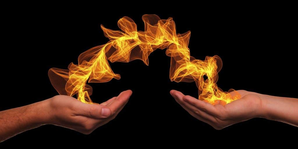 two hands with fire energy bridge